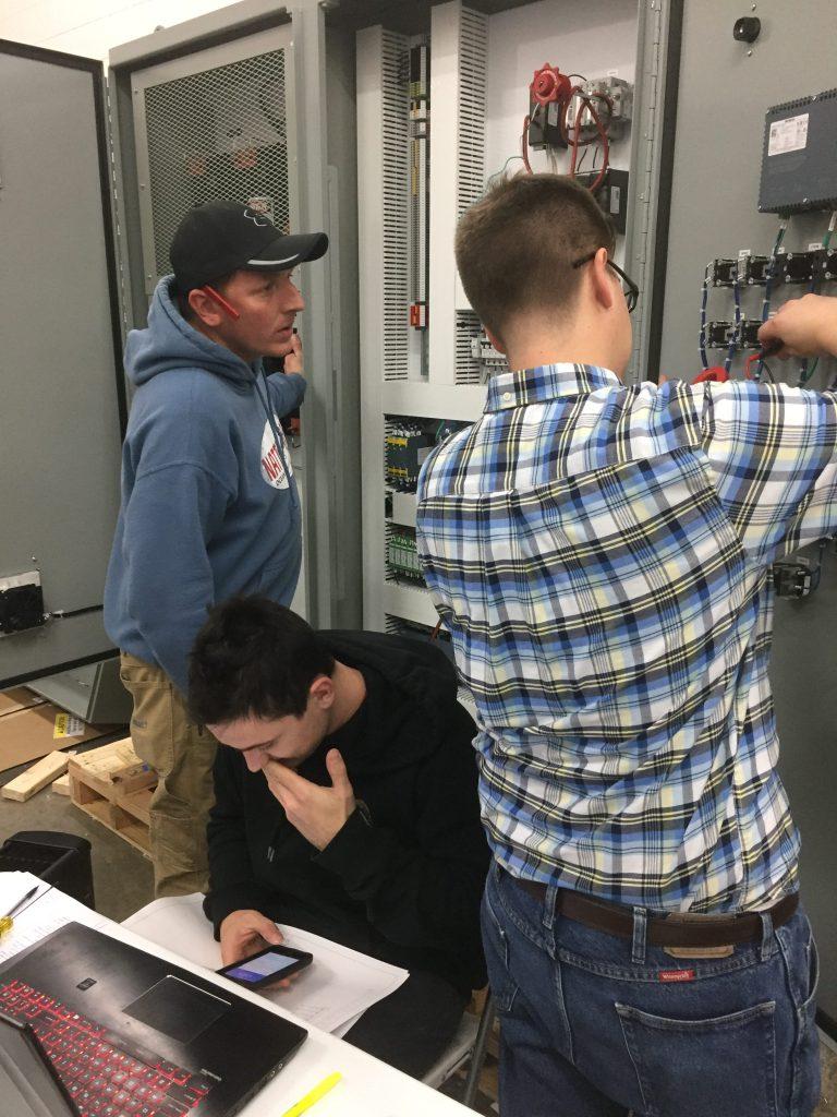 Pendant team wiring a control panel